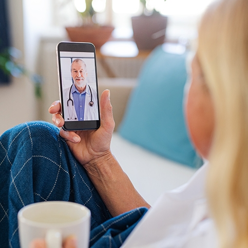 Woman having an online walk-in appointment with a doctor on her phone.