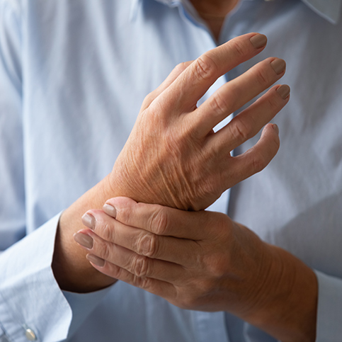 person experiencing chronic wrist pain