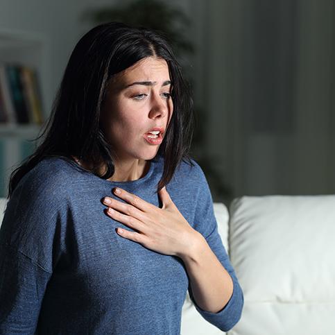 woman having asthma attack