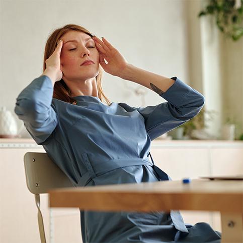 woman suffering from headache pain