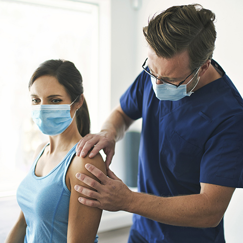 woman receiving joint pain treatment