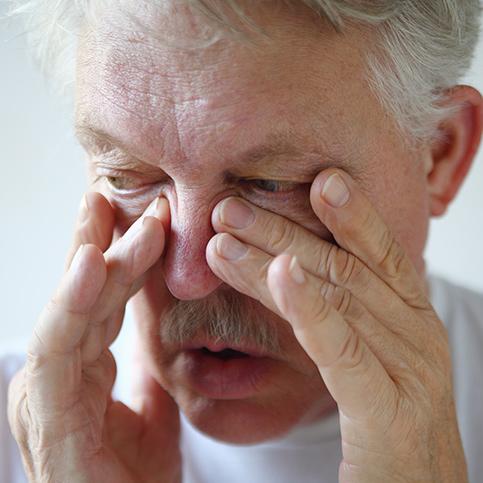 man suffering from sinusitus