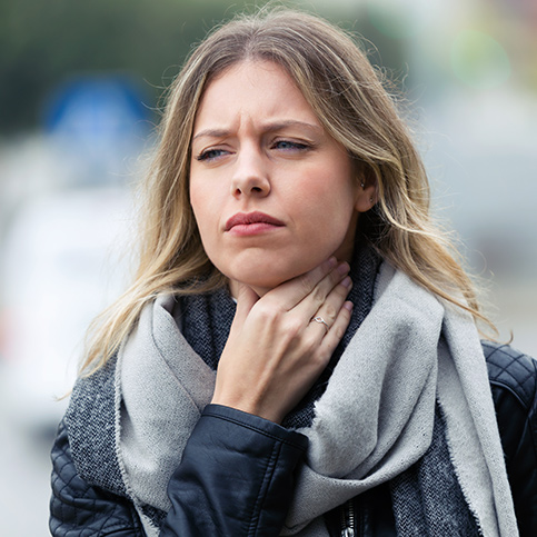 woman experiencing strep throat
