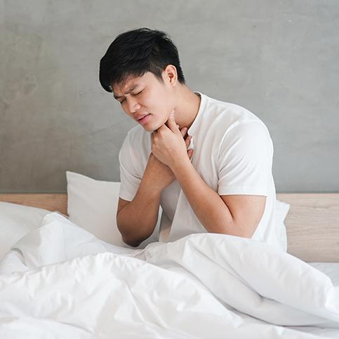 man experiencing strep throat